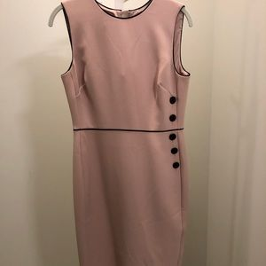 Pink dress with brown buttons up one side.